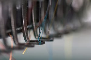the embroidery needle with thread are ready to work ** Note: Visible grain at 100%, best at smaller sizes
